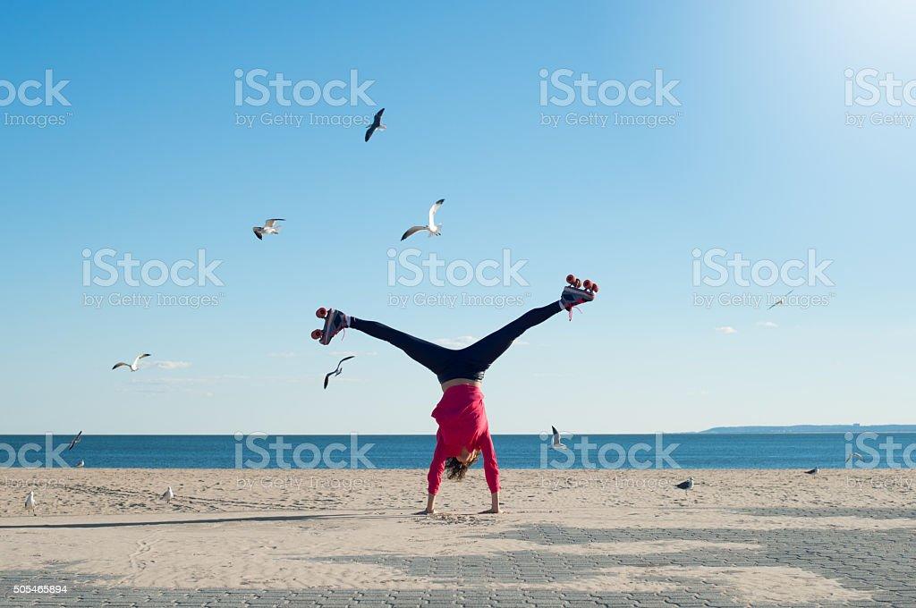 Young woman doing cartwheel stock photo