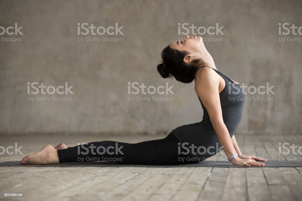 Young woman doing Cobra exercise stock photo