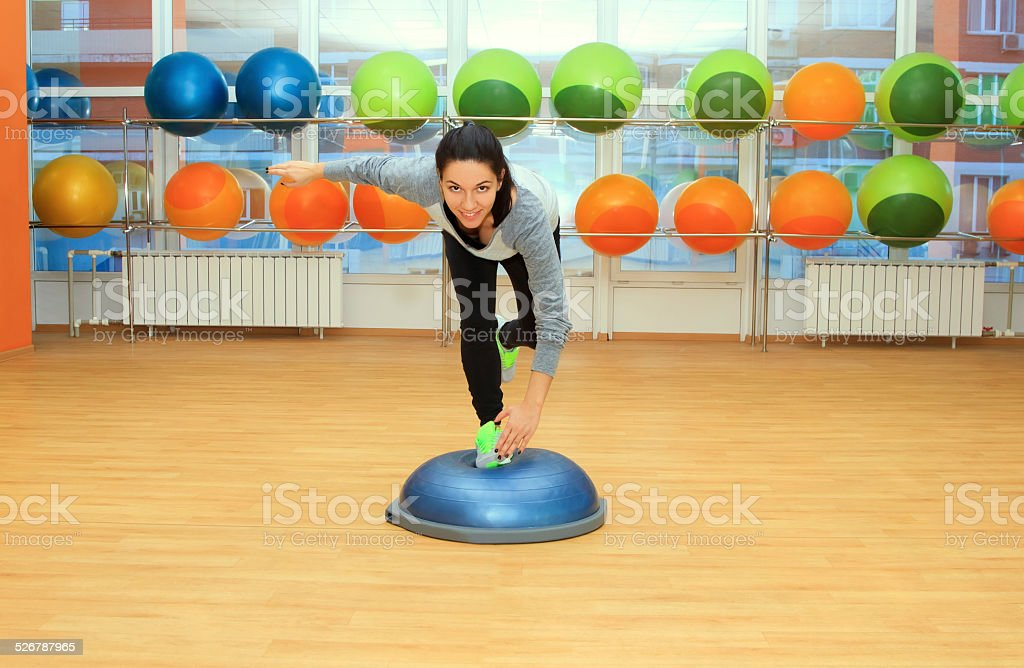 Young woman doing exercise on bosu ball - Royalty-free Active Lifestyle Stock Photo