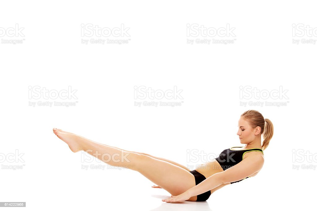 Young woman doing exercise on the floor stock photo