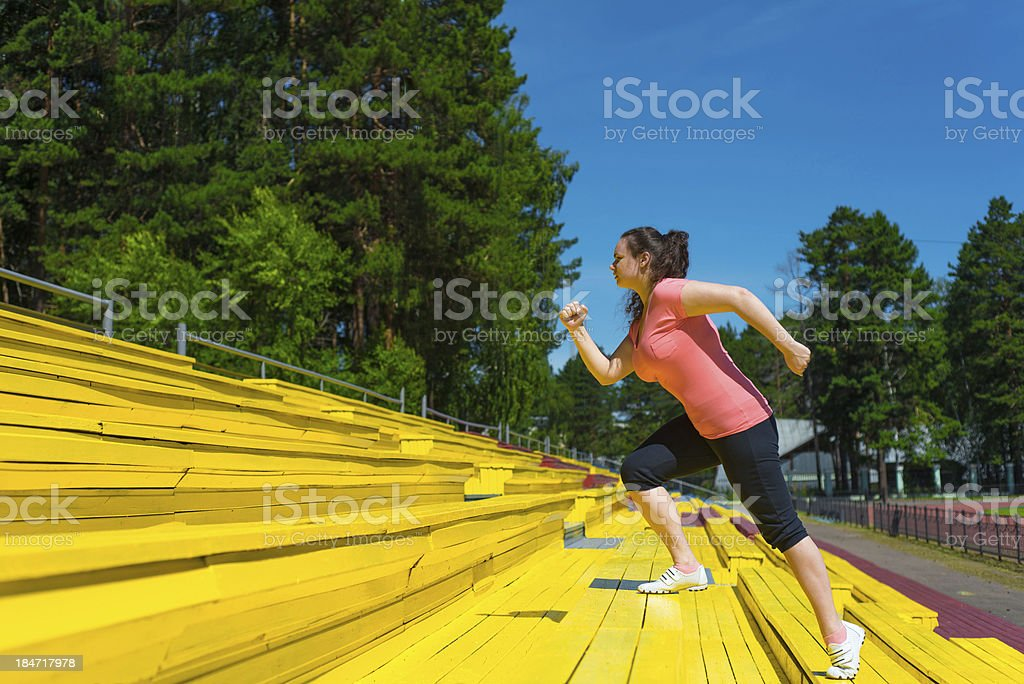 Young woman doing exercise royalty-free stock photo