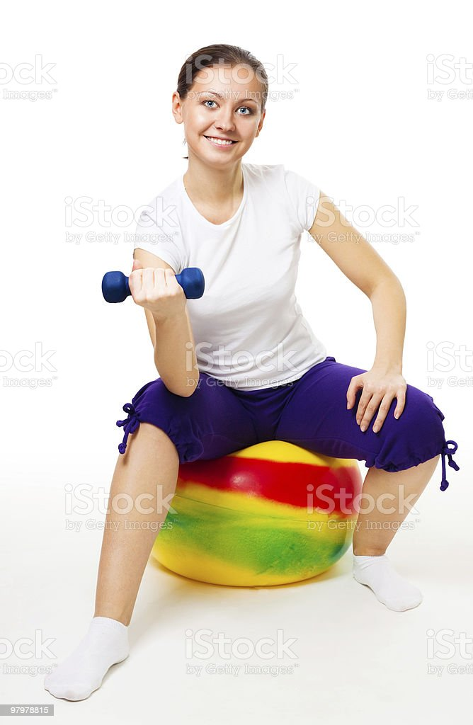 Young woman doing exercises with ball and dummbell royalty-free stock photo