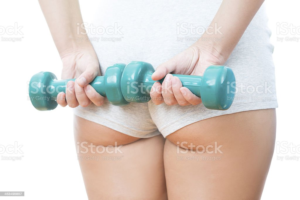 Young woman doing exercises with dumbbells stock photo