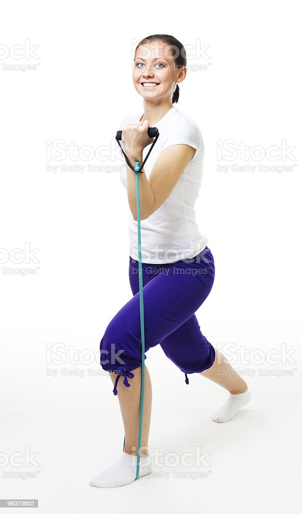 Young woman doing exercises with expander royalty-free stock photo