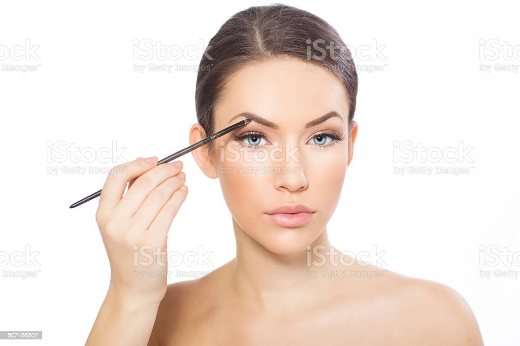 Young woman doing eyebrows stock photo
