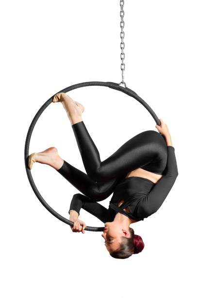 Young woman doing gymnastic exercises on the hoop stock photo