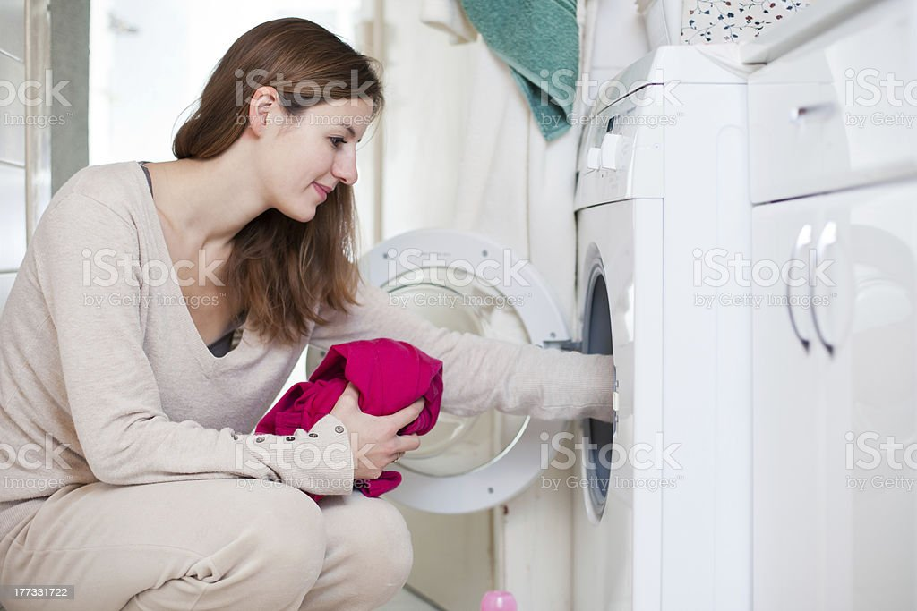 Young woman doing laundry royalty-free stock photo