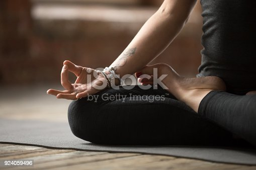 istock Young woman doing Lotus exercise, mudra gesture close up 924059496