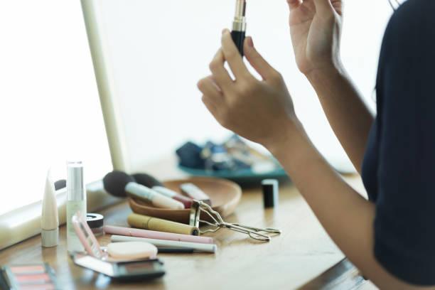 Young woman doing makeup stock photo