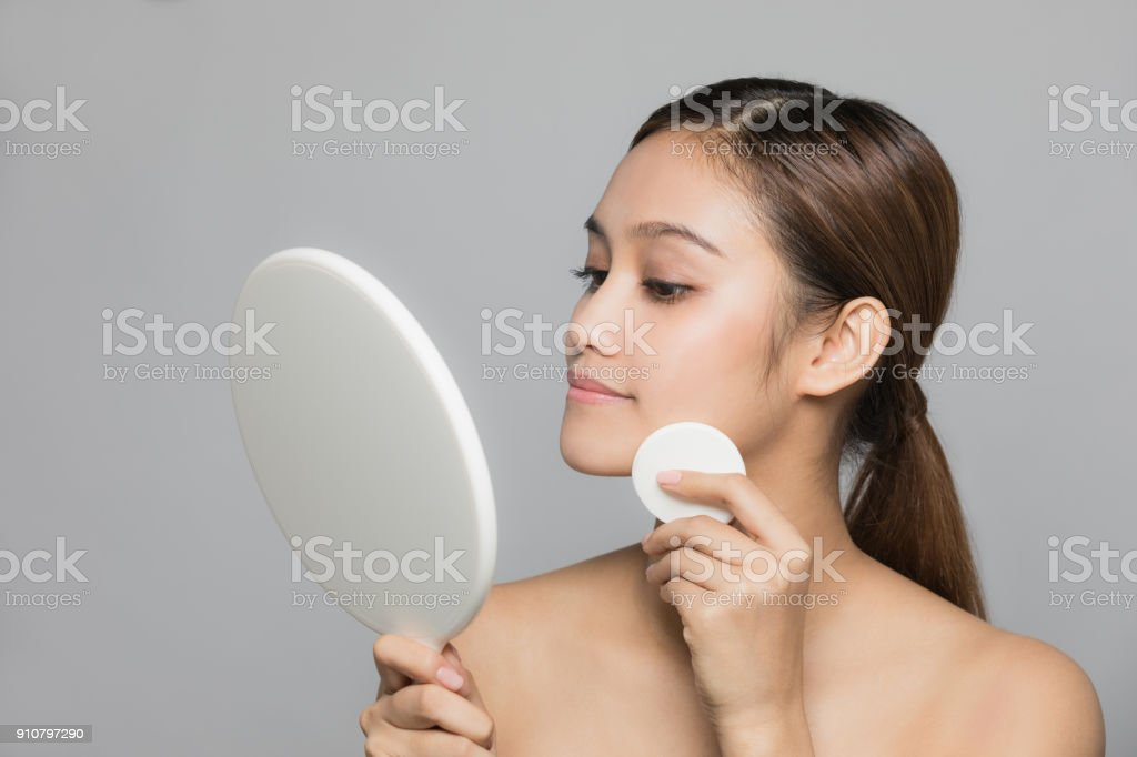 Young woman doing makeup. Skin care concept. stock photo