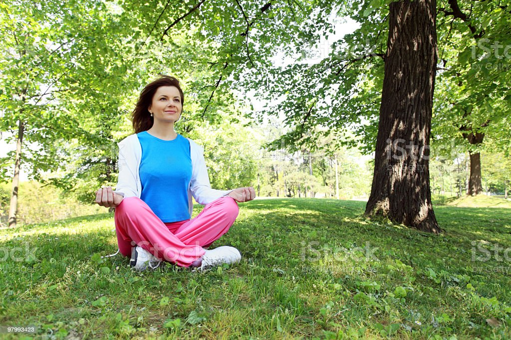 Young woman doing meditation on park. royalty-free stock photo