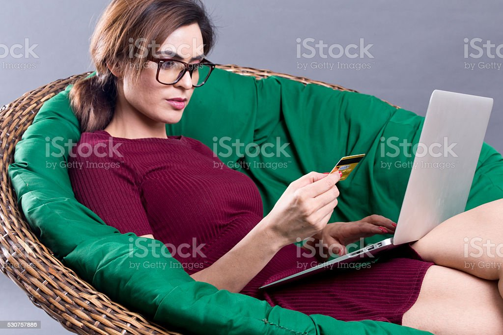 Young woman doing online shopping stock photo