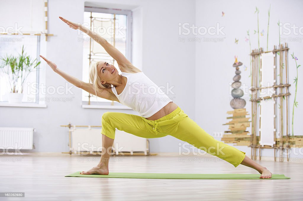 young woman doing parshvakonasana royalty-free stock photo