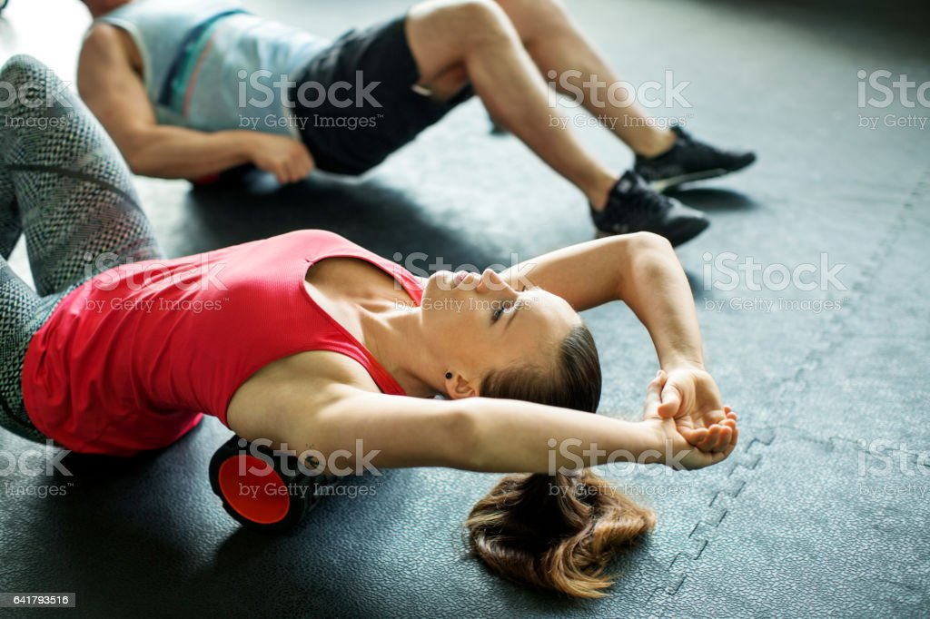 Young woman doing pilates exercise at gym stock photo
