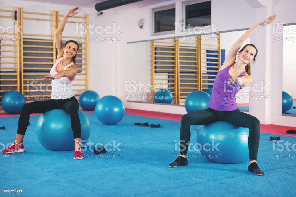 Young woman doing pilates exercises stock photo