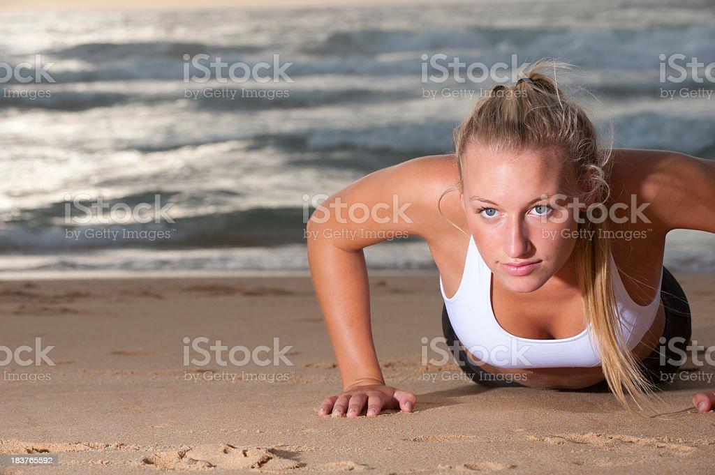 Young woman doing push ups royalty-free stock photo