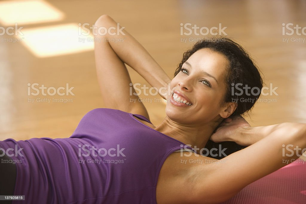 Young woman doing sit-ups royalty-free stock photo