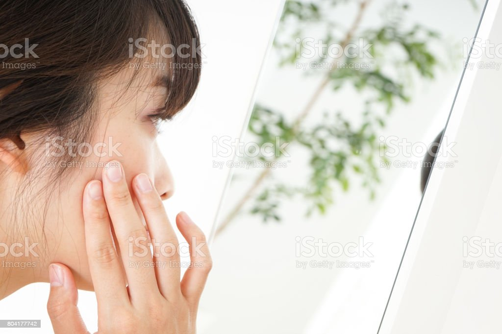 Young woman doing skin care stock photo
