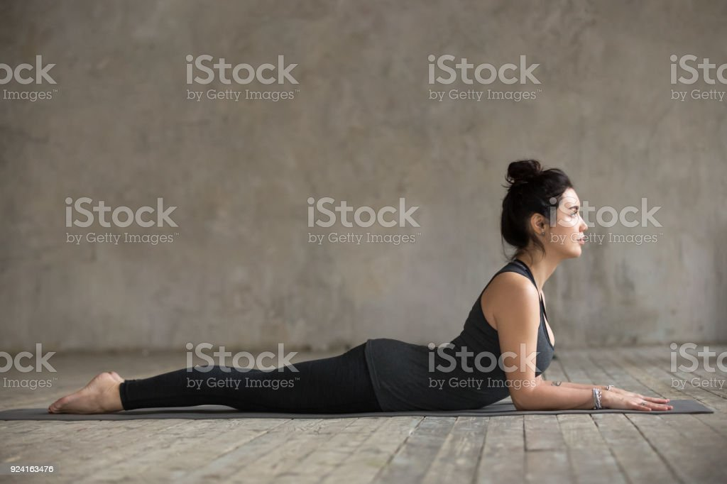 Young woman doing Sphinx exercise stock photo