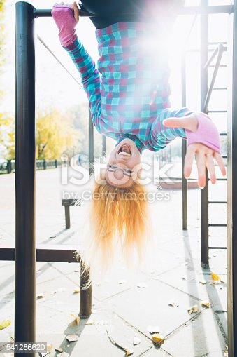 istock Young woman doing street workout at calisthenics park 541286620