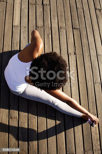 520047182istockphoto Young woman doing stretching exercise at beach 639024548