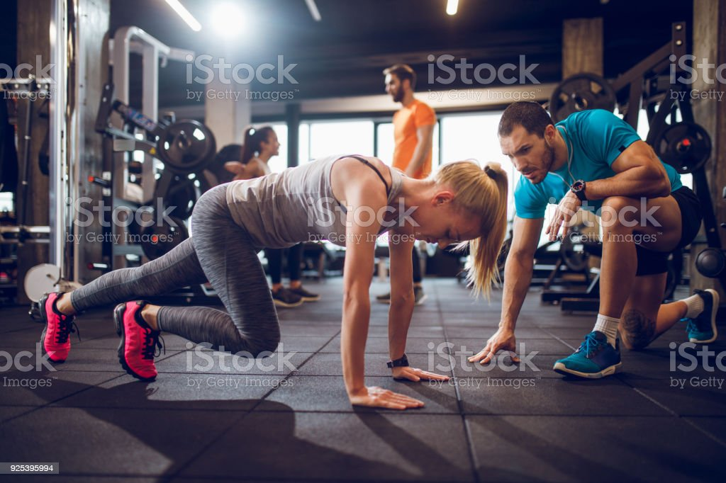 Young woman doing stretching exercise stock photo