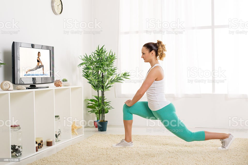 Young Woman Doing Stretching Exercises stock photo