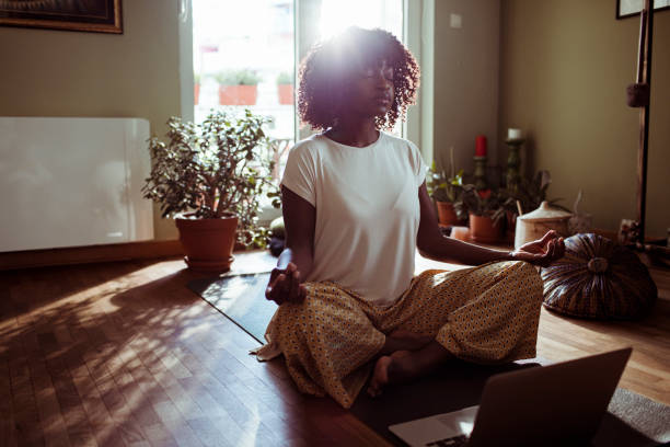 young woman doing yoga at home - meditation stock pictures, royalty-free photos & images