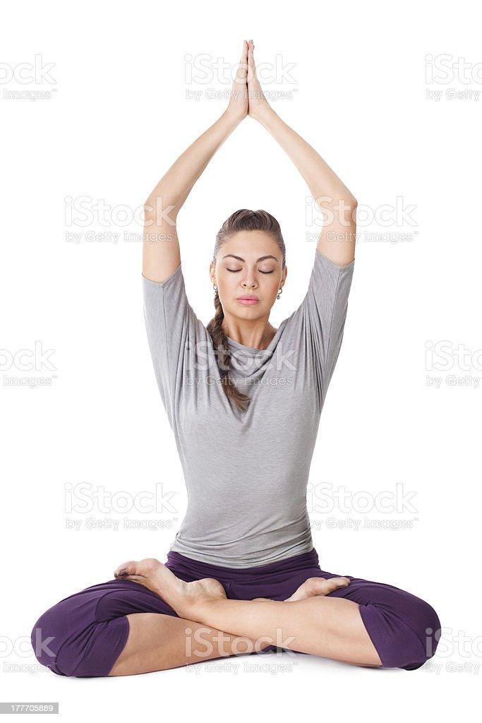 Young woman doing yoga exercise Padmasana (Lotus Pose). royalty-free stock photo