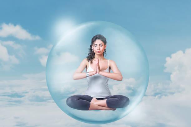 Young woman doing yoga meditation