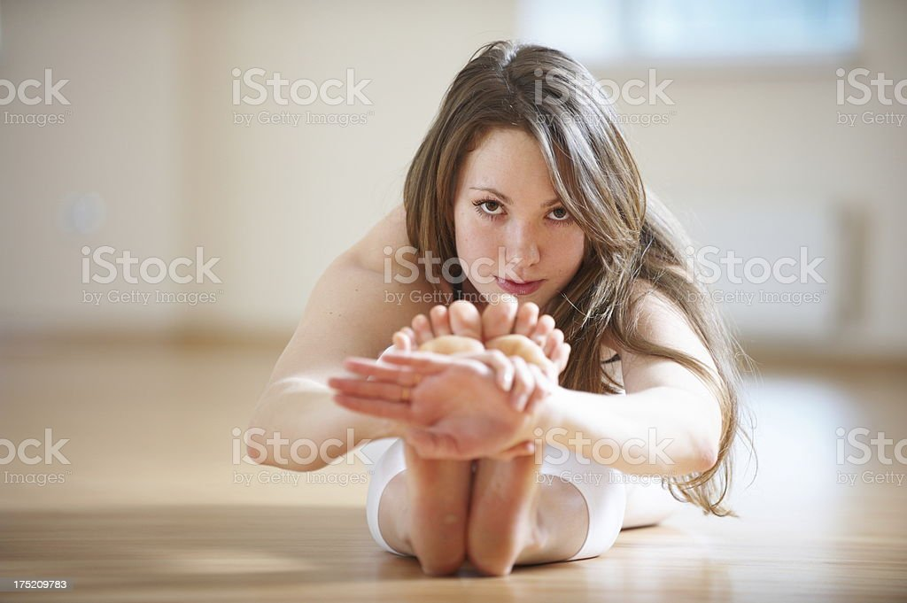 young woman doing yoga royalty-free stock photo