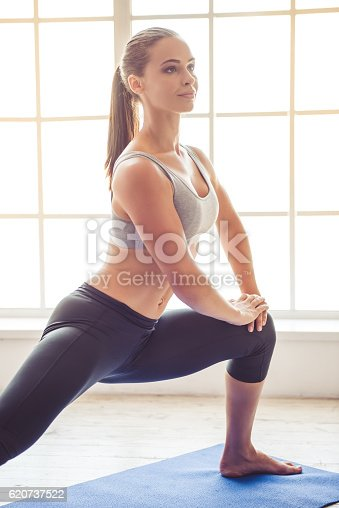 istock Young woman doing yoga 620737522