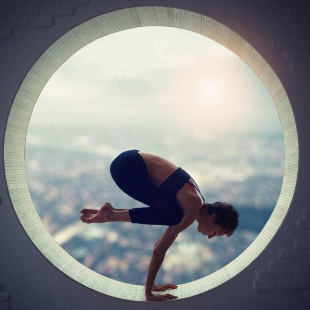 young woman doing yoga stock photo