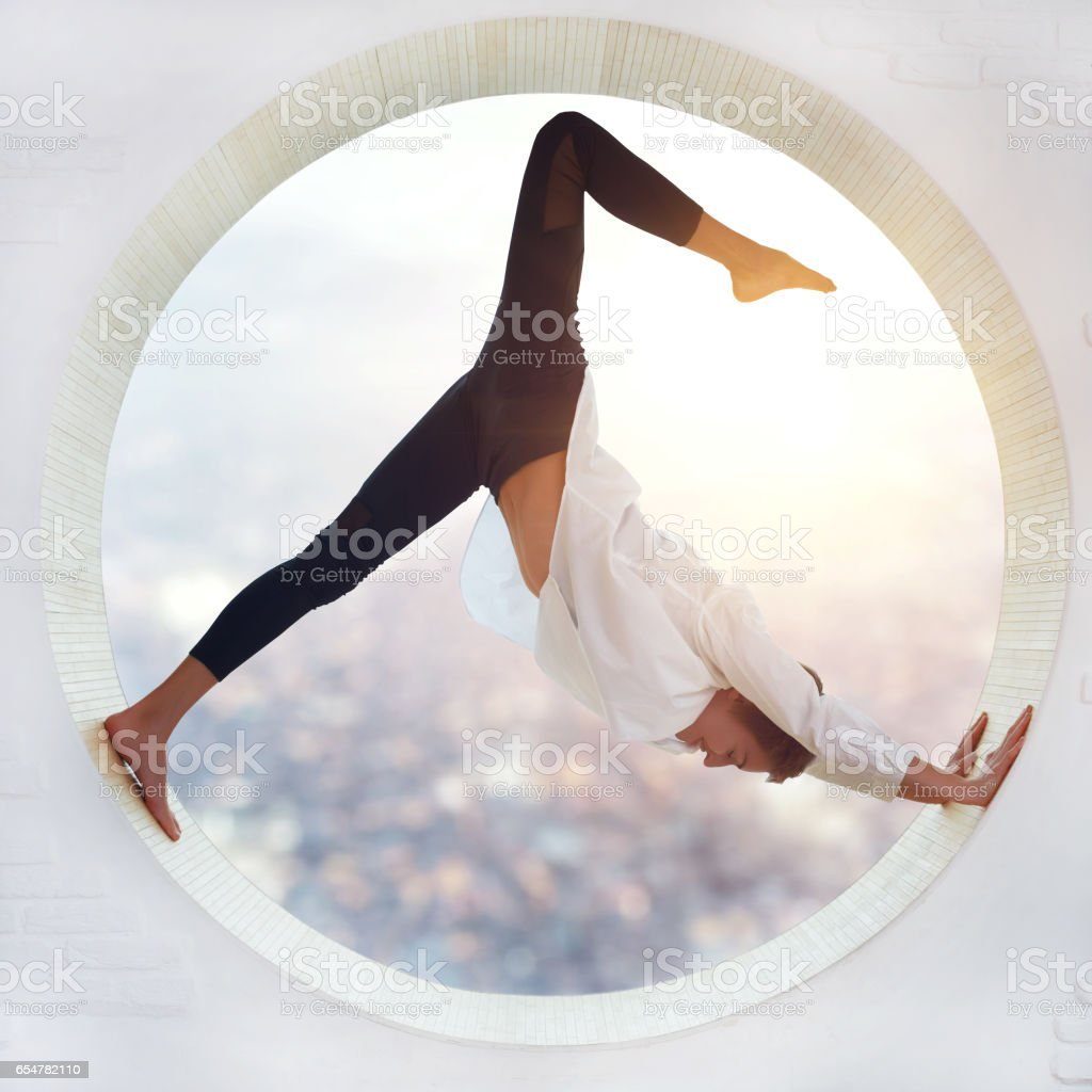 Young woman doing yoga - Royalty-free 20-29 Years Stock Photo
