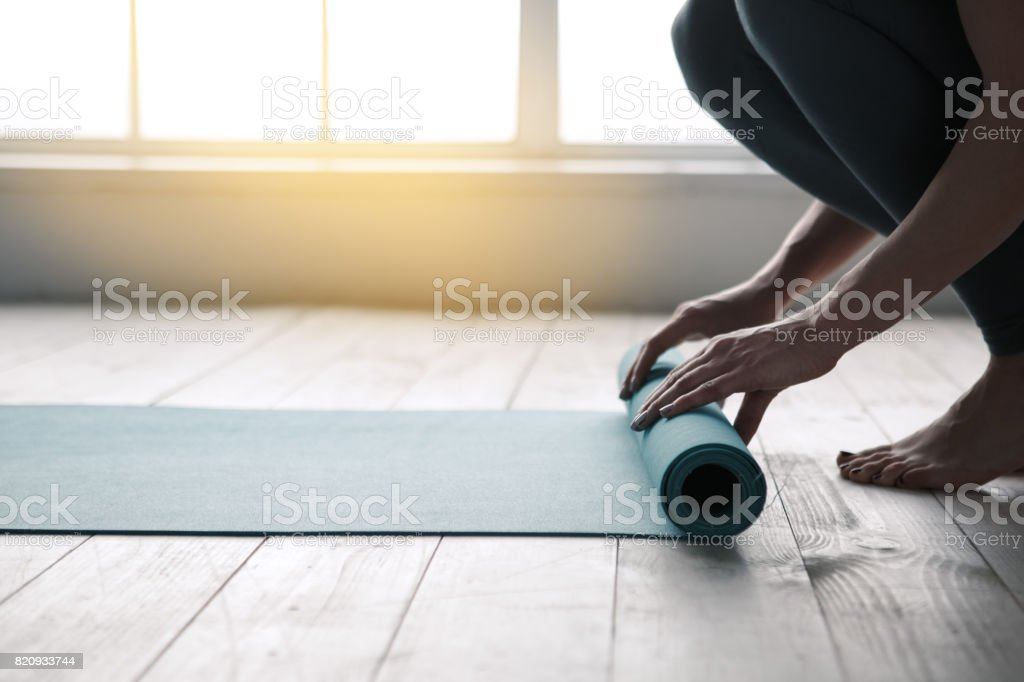 Young Woman Doing Yoga Twist Mat Healthy Lifestyle stock photo
