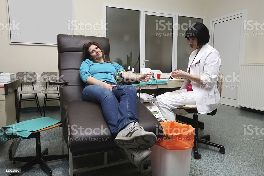 Young woman donating blood royalty-free stock photo