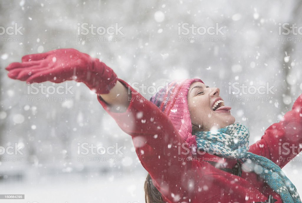 Young woman doors with arms raised stock photo