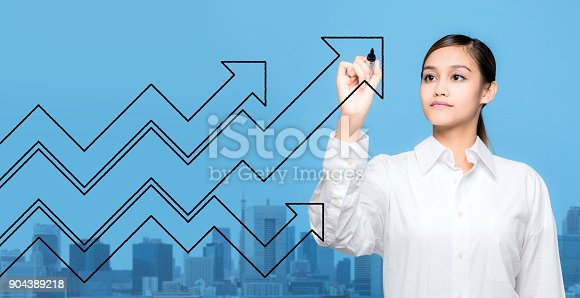 904389218istockphoto Young woman drawing arrows. 904389218