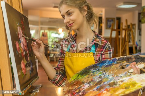 istock Young woman drawing 943414220