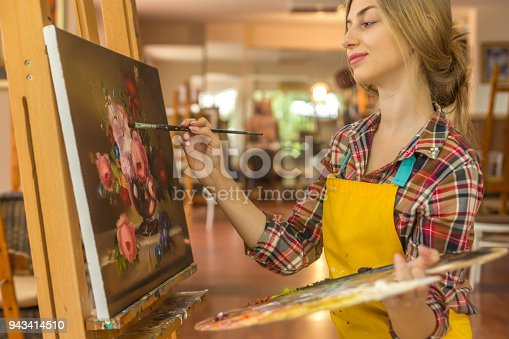 istock Young woman drawing 943414510
