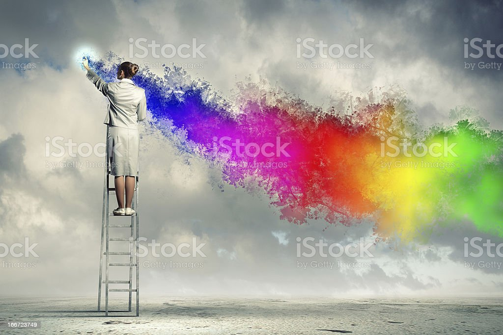 Young woman drawing splashes stock photo