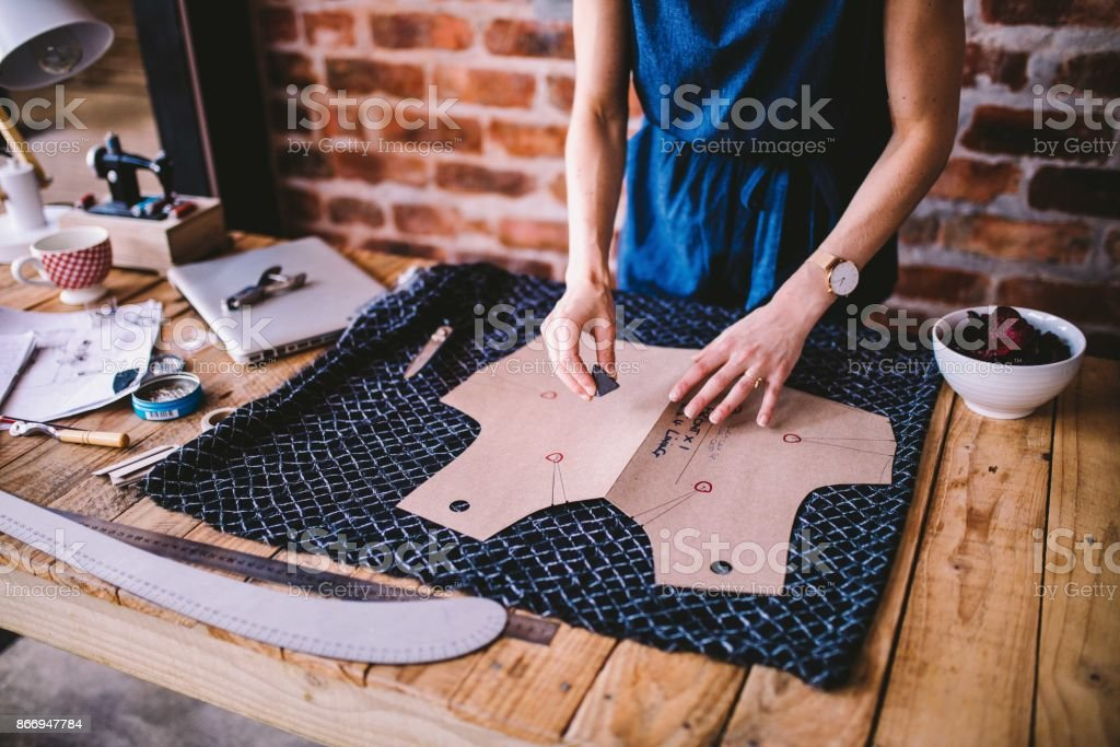 Young woman drawing template for dress design stock photo