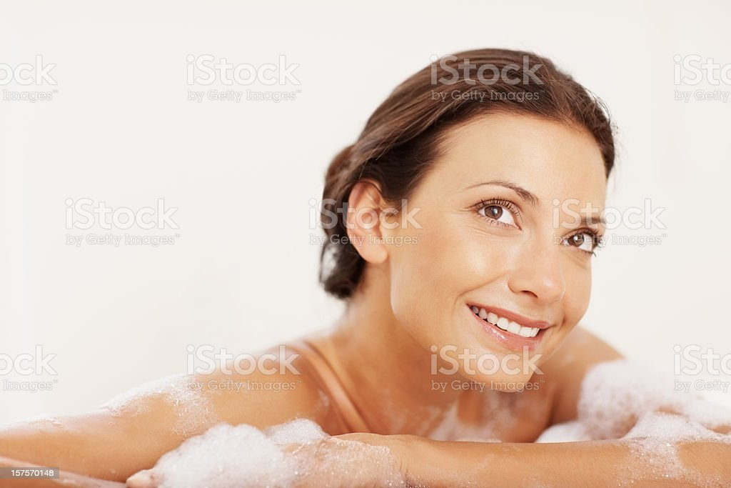 Young woman dreaming in a bathtub royalty-free stock photo
