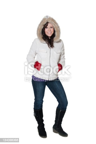 Pretty young woman in a winter coat and mittens.