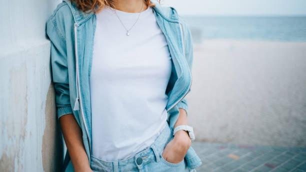 Young woman dressed in white plain t-shirt stock photo