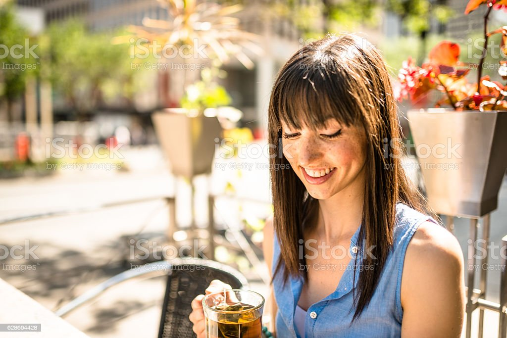 young woman drinking a tea on the city royalty-free stock photo