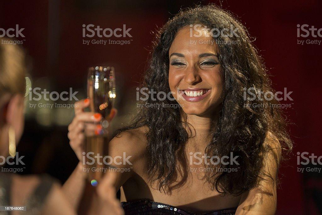 Young Woman Drinking At A Bar royalty-free stock photo