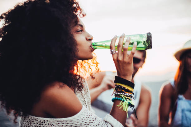 Young woman drinking beer stock photo