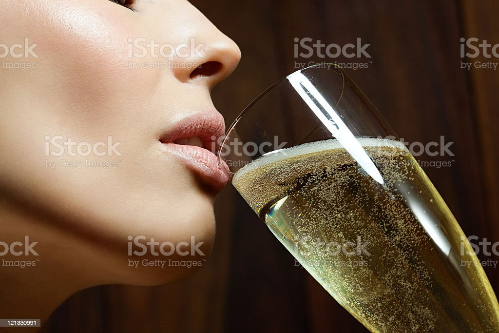 Young woman drinking champagne stock photo