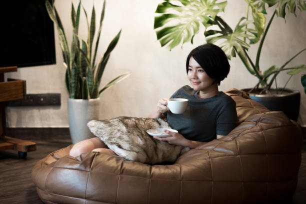 Young woman drinking coffee at home. stock photo